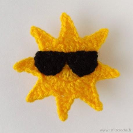 Appliqué soleil à lunettes