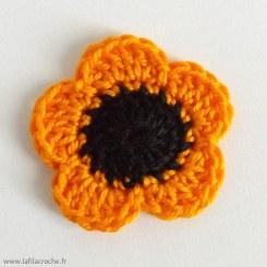 Fleur orange avec cœur noir en coton