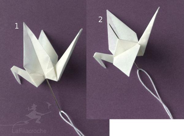 Enfiler les grues origami sur un fil